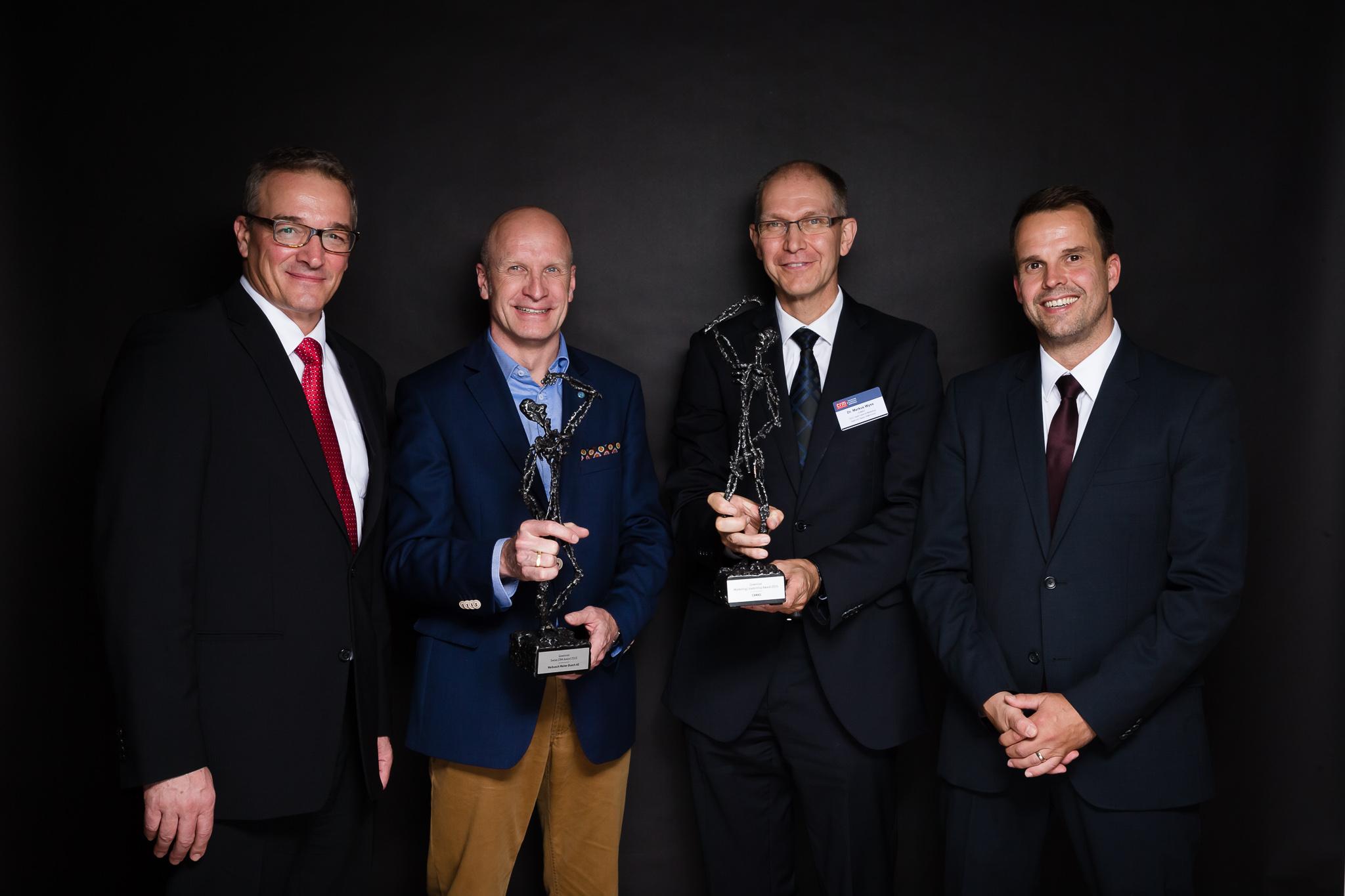 (v.l.n.r.: Stephan Isenschmid (Geschäftsführer Swiss CRM Forum), Bernhard Egger (Gewinner Swiss CRM Award, Geschäftsführer Schweiz und Österreich Walbusch), Dr. Markus Wyss (CEO, Head Sales & Marketing CAMAG) und Dr. Brian Rüeger (Leiter des Instituts für Marketing Management))