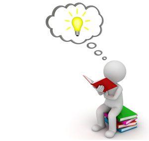 Figur sitzt auf Buch und sucht nach einer Lösung